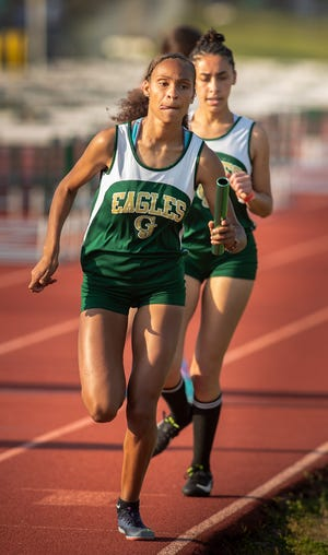 George Jenkins senior Alicia Ruiz runs the anchor leg in the Girls 4X800 event during the Lakeland City track meet at George Jenkins High School. Jenkins won the event, and Ruiz also won the 800 and the 1,600 to help lead the Eagles to the girls team title.
