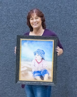 """Artist Irene Holt with """"Haley"""" in oil."""