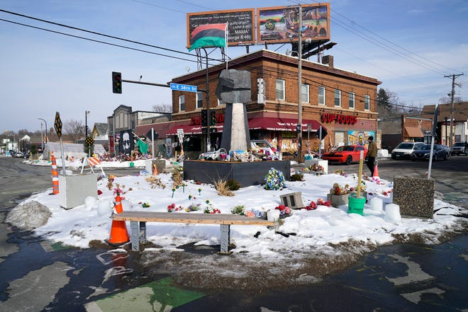 FILE - In this Feb. 8, 2021 file photo, George Floyd Square is shown in Minneapolis. The city of Minneapolis on Friday, March 12, 2021, agreed to pay $27 million to settle a civil lawsuit from George Floyd's family over his death in police custody, as jury selection continued in a former officer's murder trial. The settlement includes $500,000 for the south Minneapolis neighborhood that includes the 38th and Chicago intersection that has been blocked by barricades since his death, with a massive metal sculpture and murals in his honor. (AP Photo/Jim Mone File)