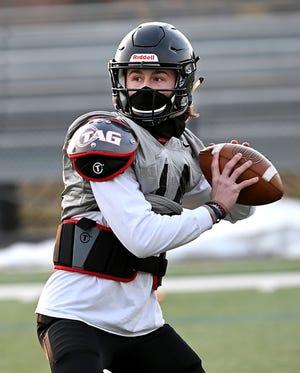 Bellingham quarterback Gavin Elder prepares to pass during practice on March 11, 2021. Elder helped the Blackhawks beat Dover-Sherborn on Saturday.