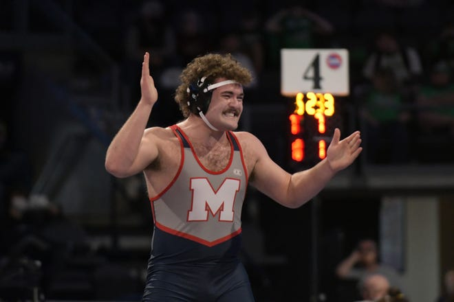 Moberly High School senior Jarrett Kinder celebrates after earning his semifinal win Thursday at the 2021 MSHSAA Class 2 Wrestling Championships held at Cable Dahmer Arena in Independence. Kinder ended up as state runner-up champion at 220-pounds.