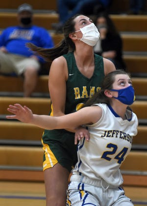 Kirsten Vanisacker of Jefferson attempts to block out Kayla Giroux of Flat Rock on a foul shot Thursday, March 11, 2020.