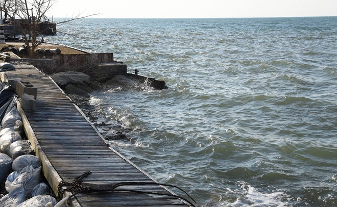 Lake Erie water levels, pictured last year in Estral Beach in Newport, are expected to remain well above average in 2021, but lower than last year's levels.