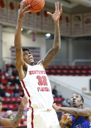 Alonzo Gaffney snags a rebound as the Raiders host the Tallahassee Eagles in their mens basketball game at The Arena.