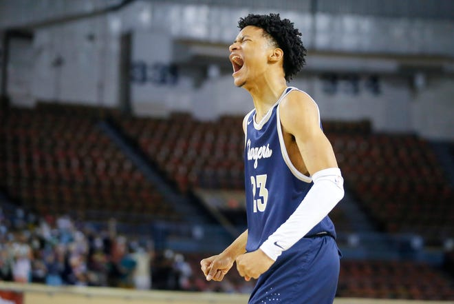 Heritage Hall's Trey Alexander celebrates during a Class 4A boys state tournament semifinal game between Heritage Hall and Tulsa Webster at State Fair Arena in Oklahoma City, Friday, March 12, 2021. [Bryan Terry/The Oklahoman]