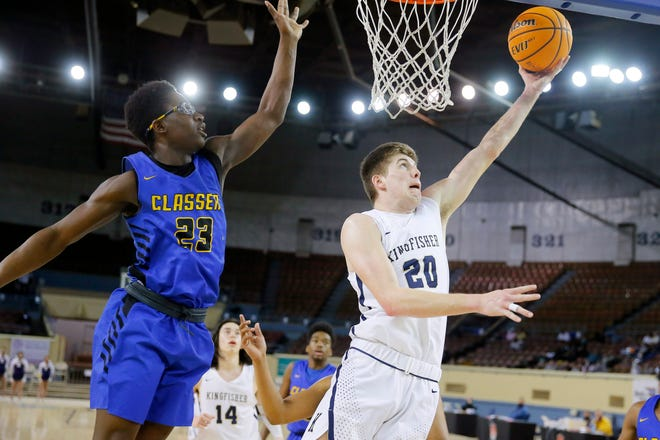Kingfisher's Jarred Birdwell goes past Anthony Turner of Classen SAS during a Class 4A boys state tournament semifinal game between Kingfisher and Classen SAS at State Fair Arena in Oklahoma City, Friday, March 12, 2021. [Bryan Terry/The Oklahoman]