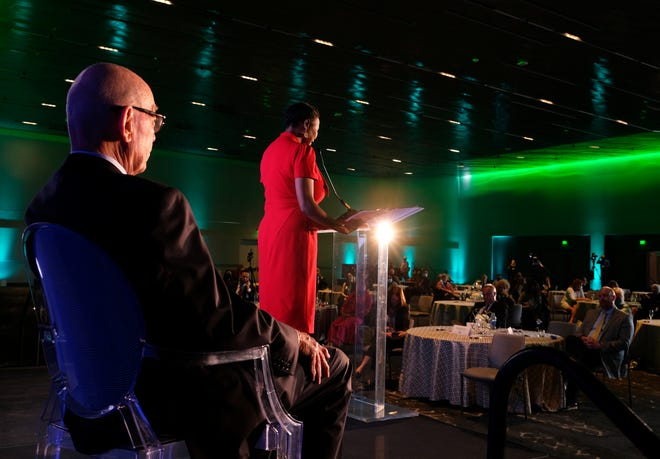 Tom McDaniel, MAPS 3 Citizens Advisory Board chairman, listens as Ward 7 Councilwoman Nikki Nice delivers remarks Thursday during the dedication of the Oklahoma City Convention Center. The invitation-only event was in the new convention center's upper level Painted Sky Ballroom.