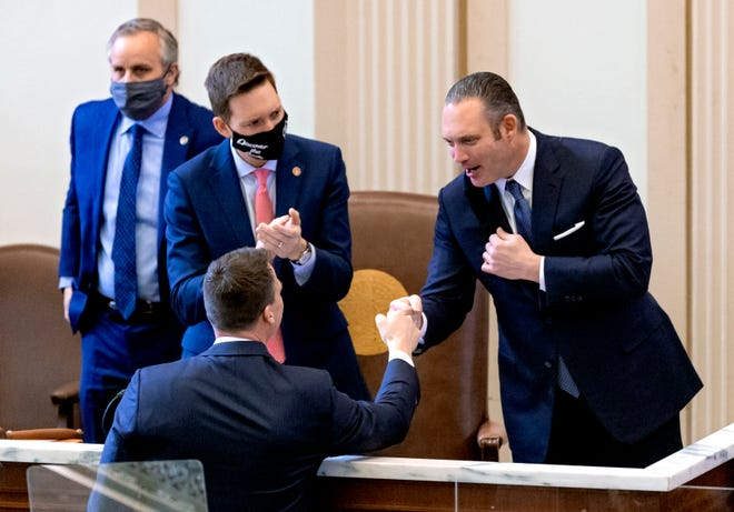 House Speaker Charles McCall, right,  congratulates Gov. Kevin Stitt after his State of the State address in the House of Representative's chamber at the Oklahoma state Capitol in Oklahoma City, Okla. on Monday, Feb. 1, 2021.   [Chris Landsberger/The Oklahoman]