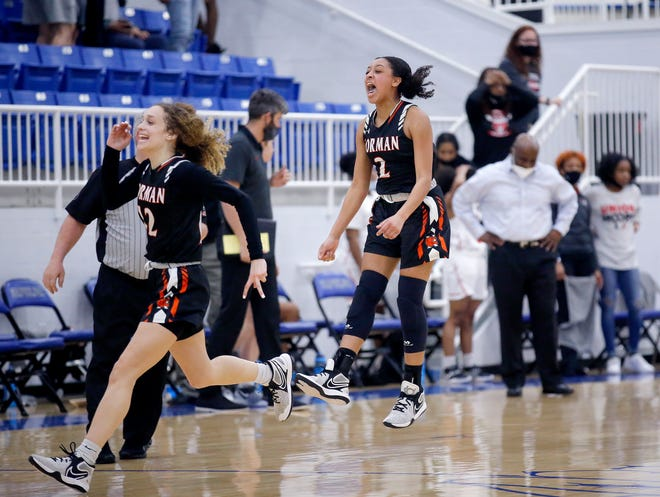 Norman's Zya Vann (2) and Mikayla Parks (12) celebrate following a 53-50 win Friday in a Class 6A state semifinal over Union in Sapulpa. [Sarah Phipps/The Oklahoman]