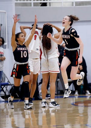Norman's Myka Perry (1) and Kelbie Washington celebrate following a Class 6A girls high school semifinal basketball state championship tournament game between Norman and Union at Sapulpa High School in Sapulpa, Okla., Friday, March 12, 2021. [Sarah Phipps/The Oklahoman]
