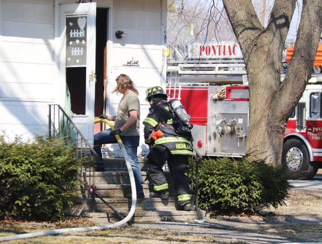 Fire personnel prepare to enter the residence at 325 E. Chestnut St. Tuesday after a fire was reported.