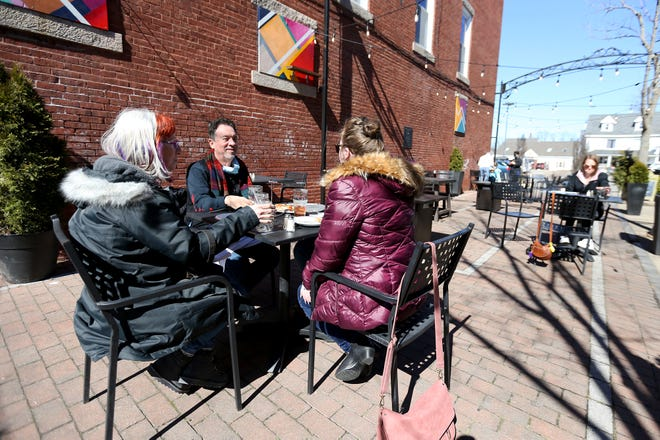 Outdoor dining will return to different parts of downtown Rochester this week, including Factory Court next to Revolution Taproom and Grill. Patrons are shown here enjoying a stretch of warm weather in Factory Court earlier in March.