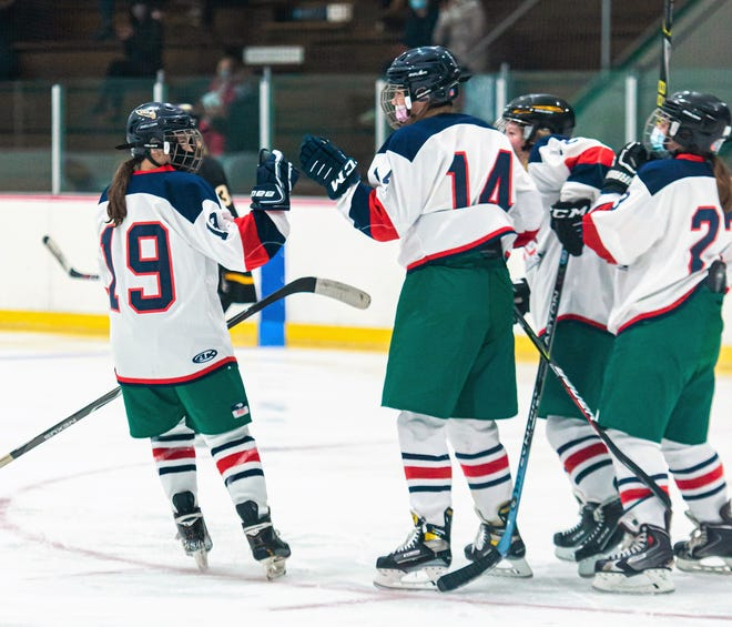 Members of the St. Thomas/Winnacunnet/Dover girls hockey team celebrate a goal earlier in the year against Souhegan. The Saints play Bishop Guertin on Saturday for the state championship.