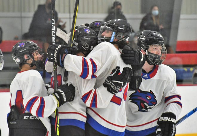 Somersworth/Coe-Brown's Aaron Bono, center, celebrates a playoff goal against Kingswood in the first round last week. The Bearcats will play Dover in Saturday's Division II championship at the Dover Ice Arena.