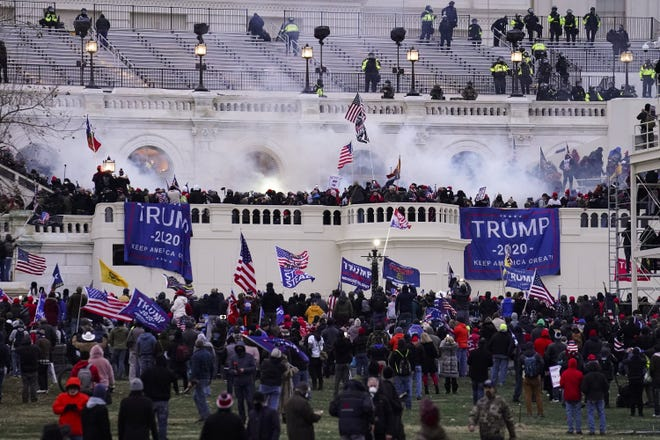 Rioters storm the U.S. Capitol on Jan. 6 in Washington. [AP Photo/John Minchillo, File]