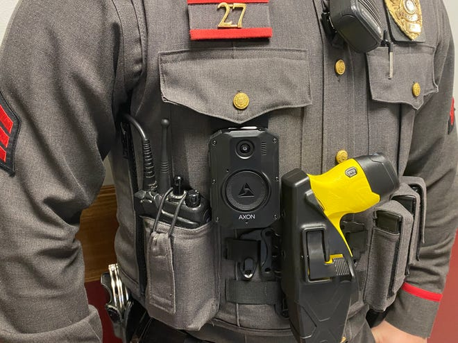 An East Providence police officer wears a body camera. Rhode Island Attorney General Peter Neronha and State Police Supt. James Manni are seeking public input on best practices for camera use.