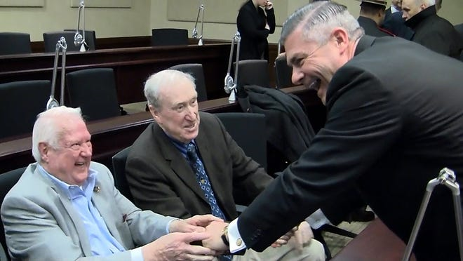 Retired Major Peter O'Connell, center, and retired Capt. Bill Partington, left, greet Col. Brendan Doherty on Doherty's last day as superintendent of the Rhode Island State Police in March 2011.