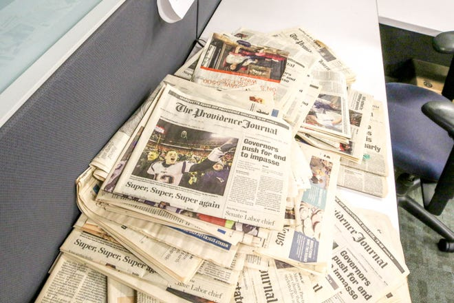 Old newspapers on the desk at the Journal newsroom
