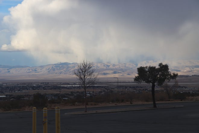 Clouds loom over the mountains located on China Lake Base.