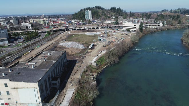 An aerial view of the Downtown Riverfront Park area in Eugene including the old EWEB steam plant at left.