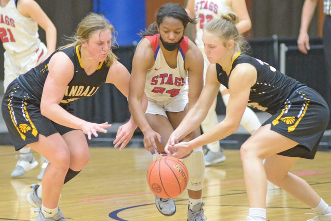 Bishop Miege's Emajin McCallop (24) goes after a loose ball between Andale's Katelyn Fairchild (3) and McKenzie Fairchild (33) during the fourth quarter of their Class 4A state semifinal game Friday at Tony's Pizza Events Center on Friday.