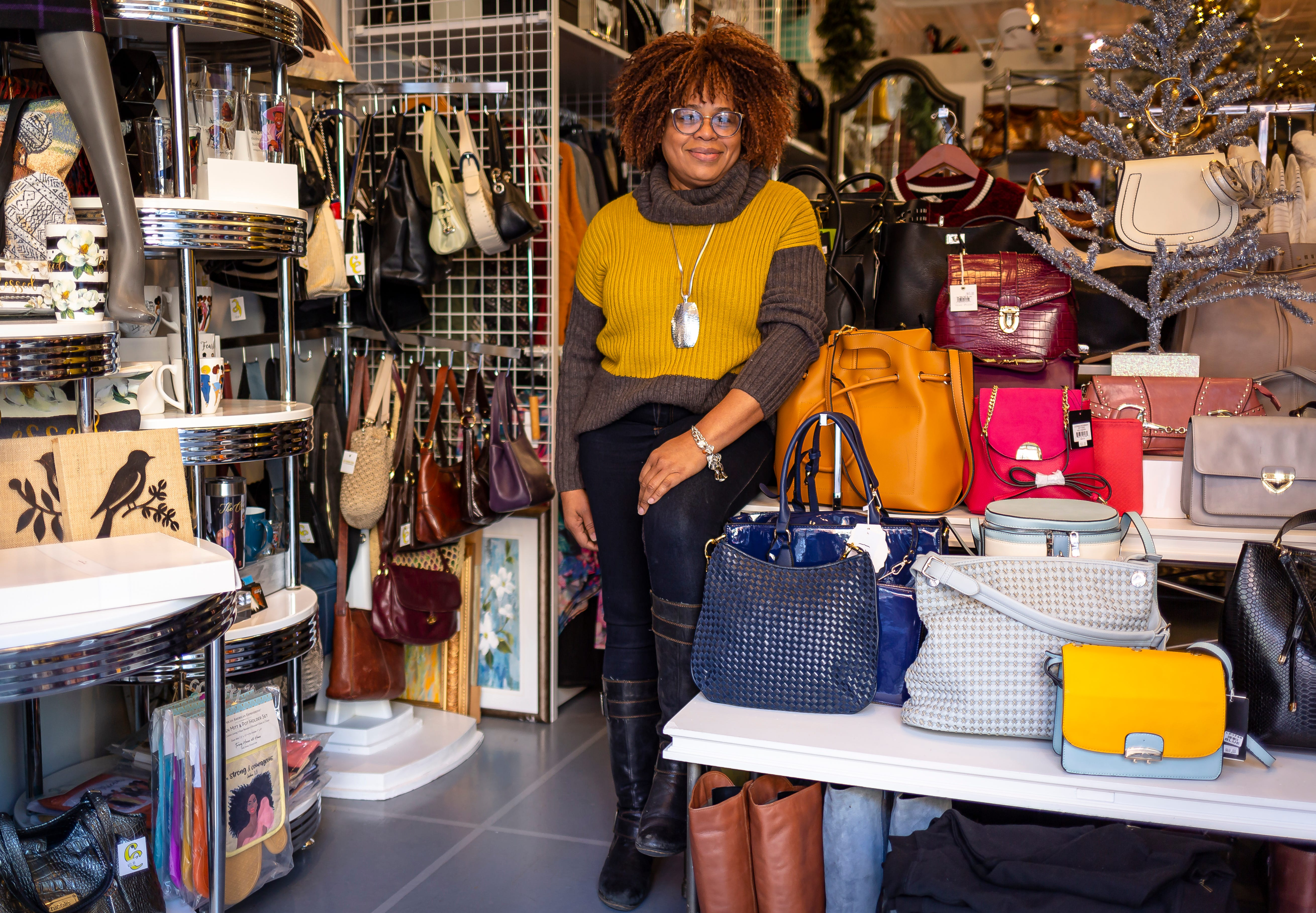 Corrine Campbell, the owner of Corrine's Closet, at 223 S. Sixth Street in Springfield, Ill. Campbell estimates she has seen about a 50% decrease in revenue over the last year during the COVID-19 pandemic, and the sales that Corrine's Closet have been just enough to keep the store open and operational. [Justin L. Fowler/The State Journal-Register]