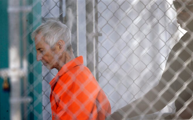 Robert Durst is escorted into Orleans Parish Prison in New Orleans after his arraignment on March 17, 2015.  Durst was rebooked on charges of being a convicted felon in possession of a firearm, and possession of a weapon with a controlled dangerous substance, a small amount of marijuana. Durst, a wealthy eccentric linked to two killings and his wife's disappearance, was arrested March 14, 2015, by the FBI on a murder warrant a day before HBO aired the final episode of a serial documentary about his life. Durst's murder trial in Los Angeles was paused in July 2020 because of the coronavirus; it has yet to resume.