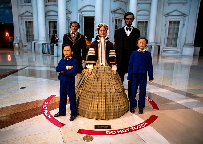 """The Lincoln family statues located in the Plaza area of the Abraham Lincoln Presidential Museum have new signage around their base that says """"Do Not Touch"""" as patrons are given new health and safety guidelines for visiting the museum as the prepare to reopen to the public during the COVID-19 pandemic, Tuesday, June 30, 2020, in Springfield, Ill. [Justin L. Fowler/The State Journal-Register]"""
