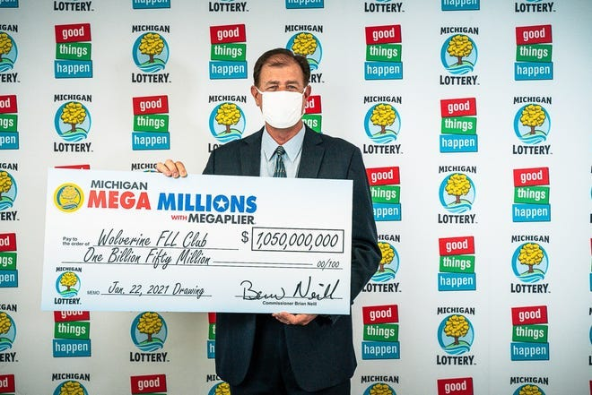 Kurt D. Panouses represents the four-member Wolverine FLL Club, which won the $1 billion Mega Millions lottery in January.