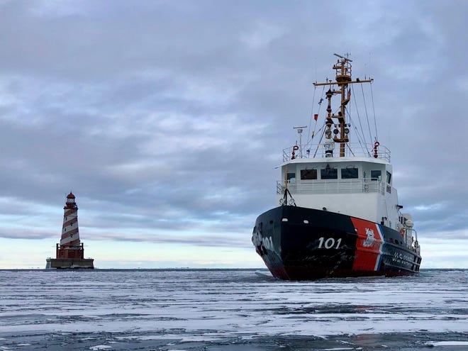 A Coast Guard boat navigating through icy waters.