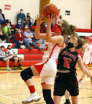 Brenna Fisher heads in for two points against Bellevue on Thursday.