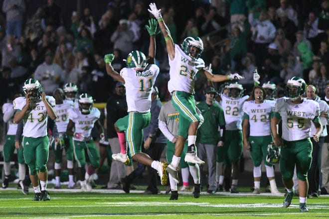 West Brunswick's Johnnie Magbie and De'Andre Clarida celebrate a touchdown last season at North Brunswick. Will there be more happy times for the Trojans tonight at Hoggard?