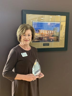 Gwen Whitley, LCFL's President and CEO, holding the award from AARP.