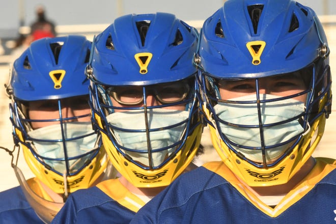 Laney High School's Nic Lord (from left),  Sam Lord and Matt Lord pose before their regular-season finale against Ashley. The triplets are wrapping up successful careers with the Buccaneers this month.