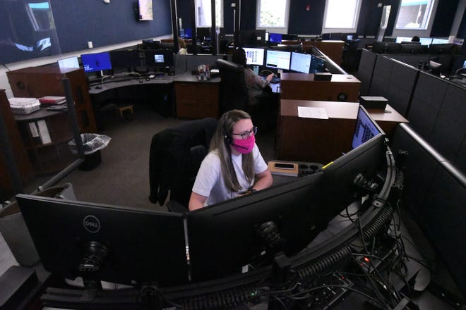 911 dispatcher Megan Lewis takes calls at the New Hanover Government Complex 911 Call Center on Thursday.