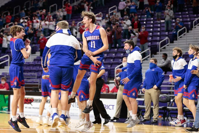 The Wabaunsee Charger bench explodes after their victory over Hoxie in Thursday's 2A semifinal game inside Bramlage Coliseum in Manhattan. The Chargers won 56-73.