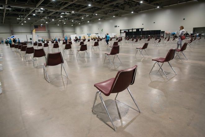 Empty chairs await patients getting their COVID-19 vaccine recently at the Stormont Vail Event Center.