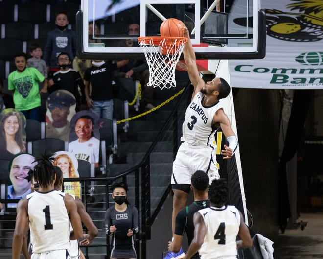 Campus senior Sterling Chapman throws down a dunk early in the fourth quarter of Thursday's Class 6A state semifinal against Free State. The dunk gave Campus the lead for good in a 42-37 Colts win at Wichita State's Koch Arena.