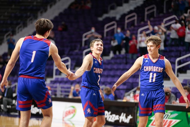 From left, Wabaunsee players Tyler Lohmeyer, Dawson Schultz and Cade Oliver congratulate each other in the final seconds of Thursday's 2A semifinal game against Hoxie. The Chargers won 56-73.