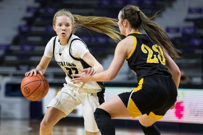 Sterling junior Kali Briar drives the ball towards the paint against Garden Plain. Sterling won 69-52 over Garden Plain during the Class 2A State semifinal game at Bramlage Coliseum Friday, March 12, 2021.