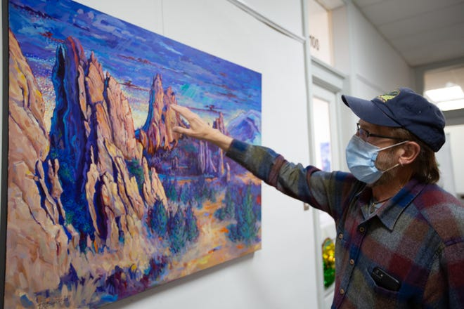 Tim Bauer, an acrylic and oil painting artist based in Topeka, explains the details in his paintings that are on display at Nexlynx, 123 S.W. 6th Ave.