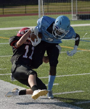 South's Angelo LaRose makes a tackle during a 2019 game.
