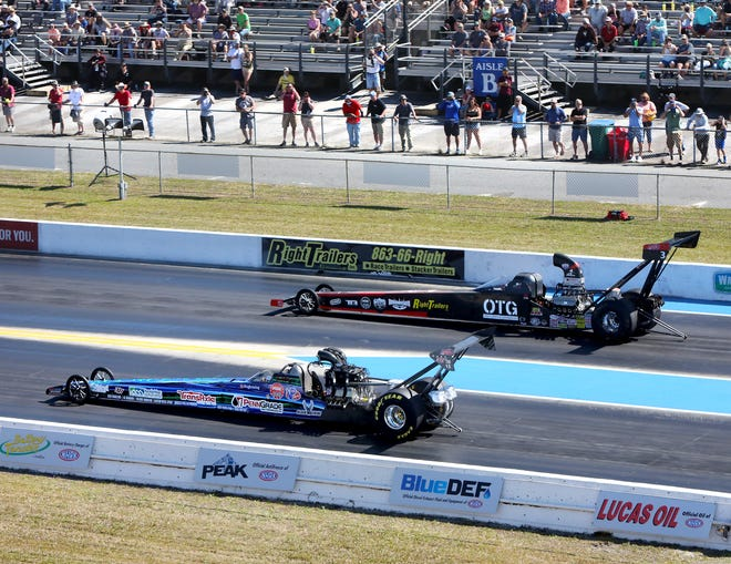 Alcohol dragsters zoom down the track during a race Friday at the AMALIE Motor Oil NHRA Gatornationals at Gainesville Raceway.