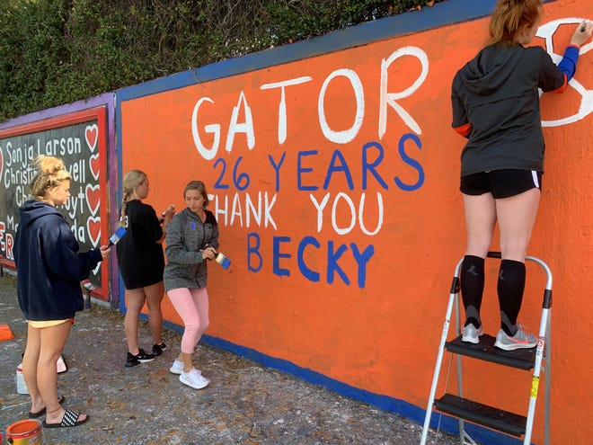 Florida soccer players leave a message on the 34th Street Wall for retiring coach Becky Burleigh.