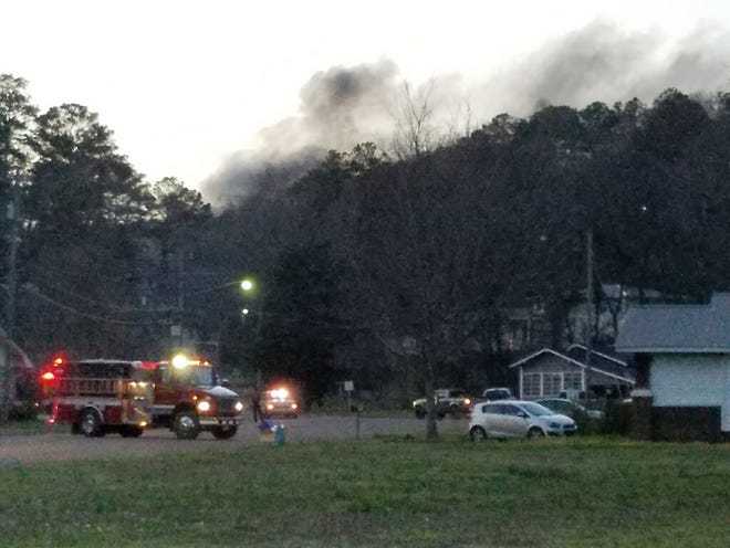 Multiple fire departments were battling a large woods fire in Attalla Thursday.