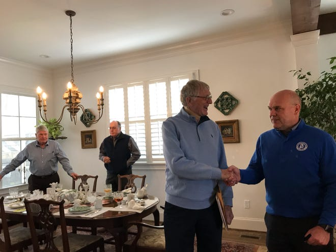 Hokes Bluff graduate Don Street and Etowah County Schools Superintendent Alan Cosby shake hands after discussing Street's plan to endow a scholarship at Hokes Bluff High School during lunch at the home of Wayne and Karen Owen.