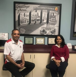 Nayan and Parul Patel are taking over a business in Newcomerstown.