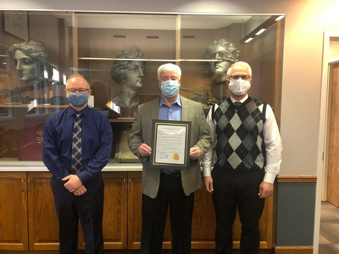 Tuscarawas County Commissioners signed a proclamation declaring March as Developmental Disabilities Awareness Month. Pictured, from left: Chris Abbuhl, Al Landis and Joe Sciarretti.