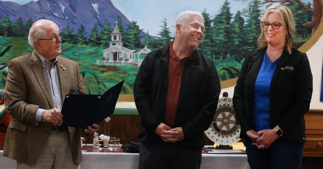 Health Care District Board President Eric Cooper and office manager Robyn Melton share a light moment with Jerry Starr at recent Rotary Club meeting.