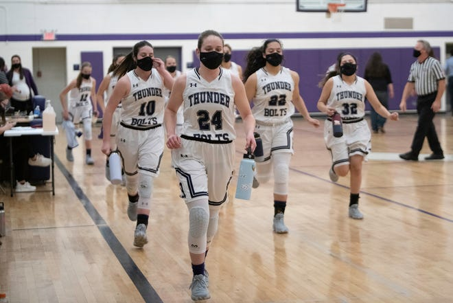 The Rye High School girls basketball team heads to the locker room at haltime of their Class 2A Sweet 16 matchup against Burlington on Thursday March 11, 2021.